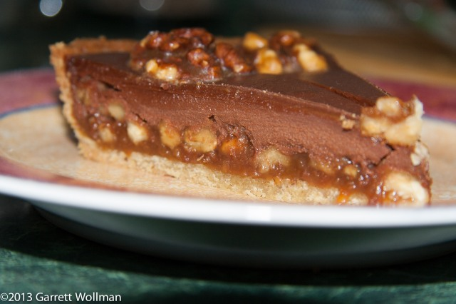 Photo showing two slices of the tart on a dessert plate, seen from the side.