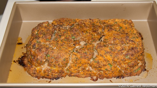 "Photo showing a cooked meatloaf in a 9""x13"" baking pan"