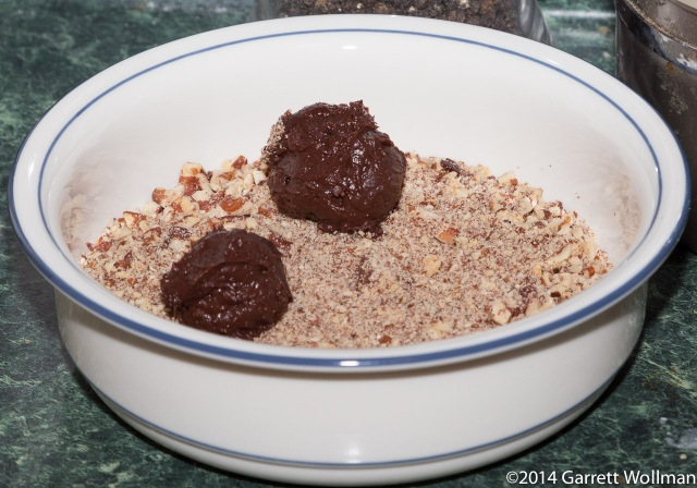 Two truffles in crushed pecan