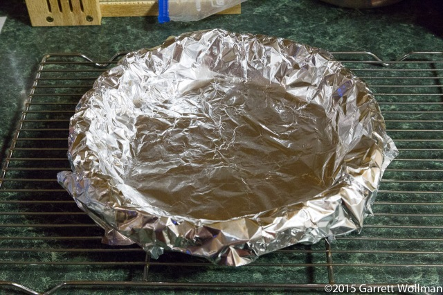 Frozen crust wrapped in foil for blind baking