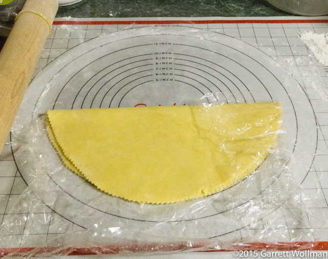 Folding bottom crust onto plastic