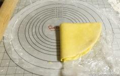 Folding bottom crust into fourths