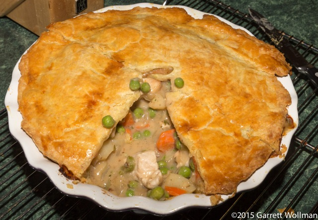Pot pie with slice removed, showing excess liquid in filling