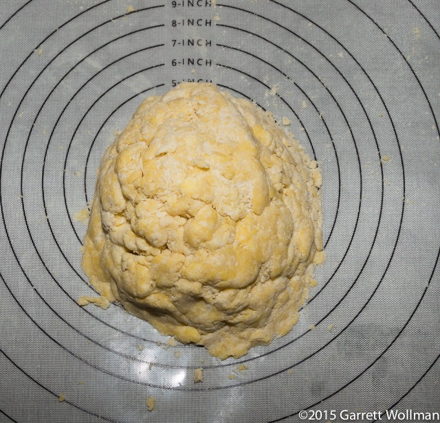 Dough shaped into a mound on pastry mat