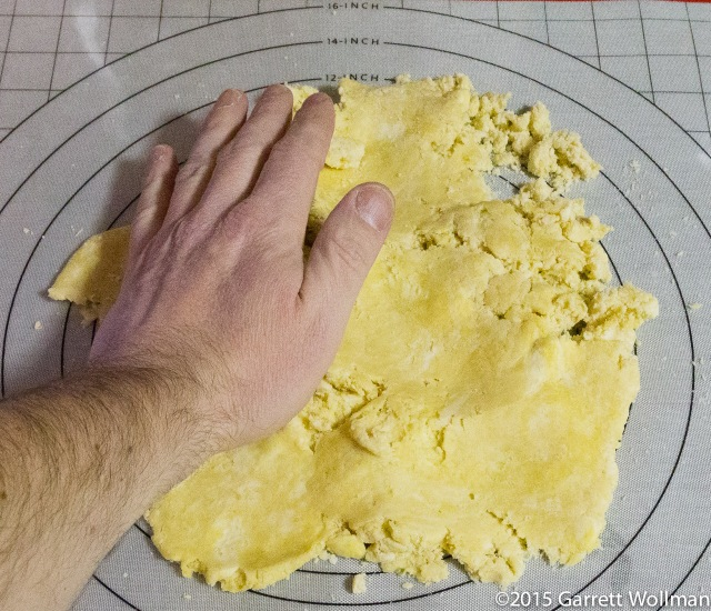 Smearing out the dough to form flakes of butter