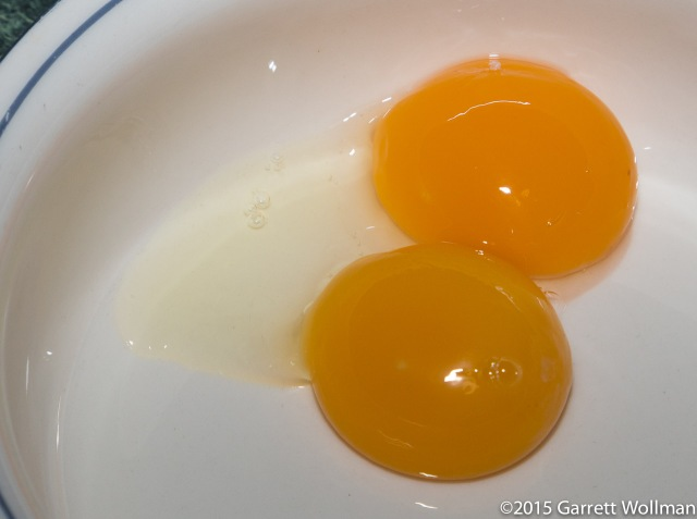 Two egg yolks (plus a little excess albumin)