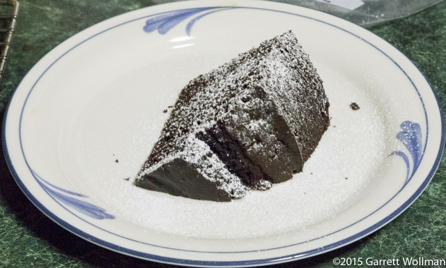One slice of cake, with powdered sugar on top