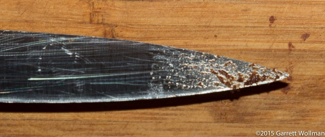 Tip of paring knife used to test cake