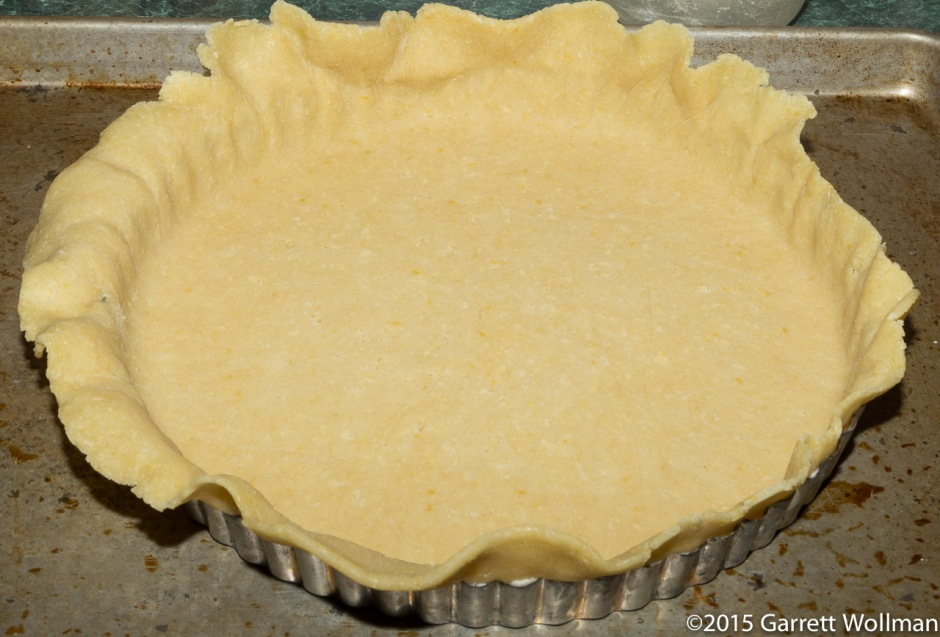 Bottom crust placed in tart pan, plastic removed