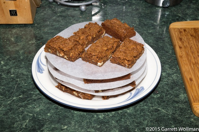 Blondies stacked on a plate for service