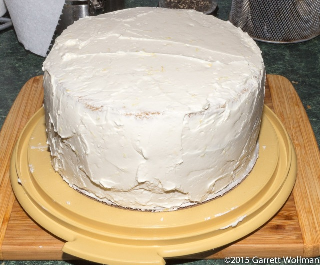 Fully assembled cake with messy frosting