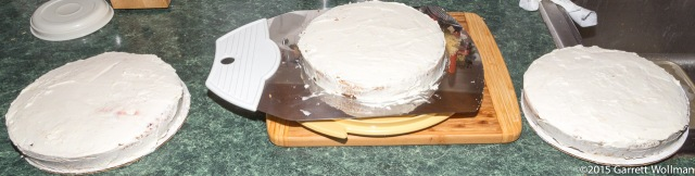 Three cake layers, filled and crumb-coated