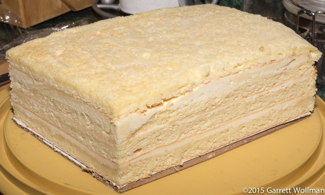 All four cake layers, filled, frozen, and trimmed