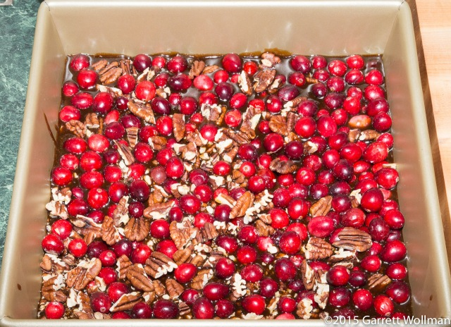 Cranberries and pecans on brown-sugar sauce