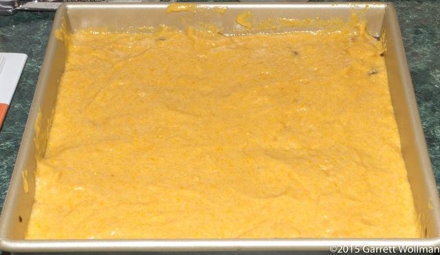 Cake batter spread on top of cranberry-pecan mixture