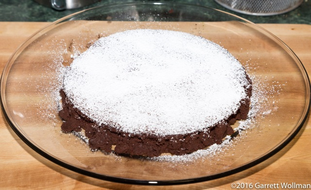 Torte on platter with a dusting of sugar