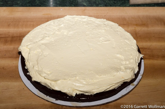 Bottom layer of cake with filling applied