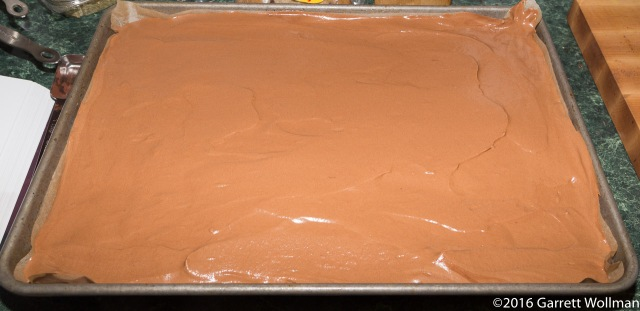 Unbaked cake batter in pan