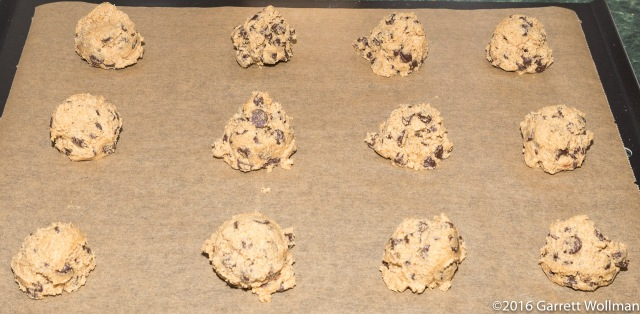 Portioned cookie dough on a baking sheet