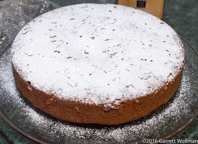 Cake on stand with powdered sugar topping