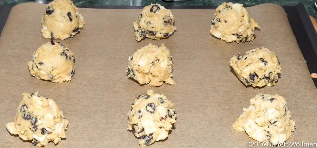 Dough balls arrayed on a baking sheet