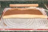 Rolling up dough sheet