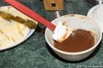 Gianduja ganache cooling next to plate of butter chunks