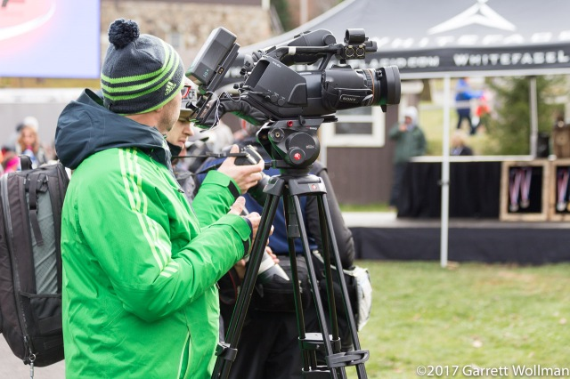 Videographer recording the medal ceremony
