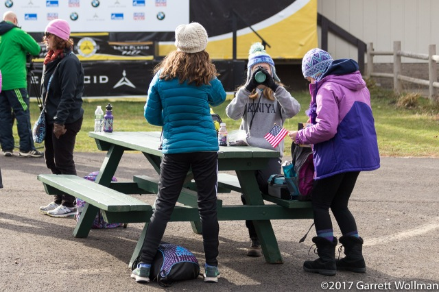Schoolchildren eating lunch at a picnic table