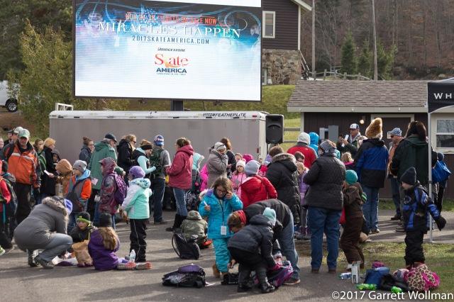 Schoolchildren in line for the signing