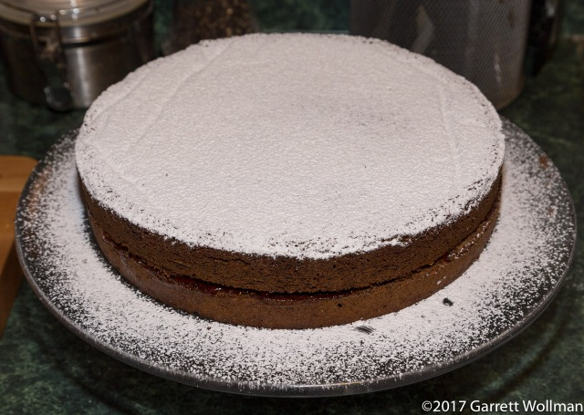 Finished Mohntorte with redcurrant filling and powdered sugar