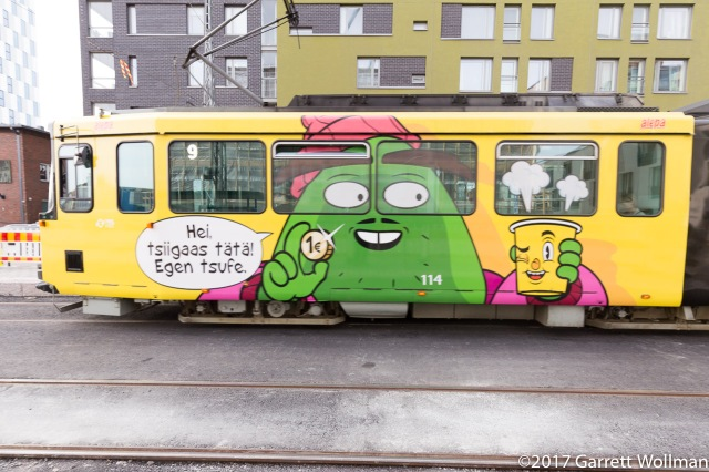 Full-wrap tram ad in Helsinki dialect