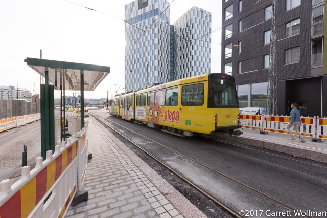 Tram departing the brand-new station on first day of operation