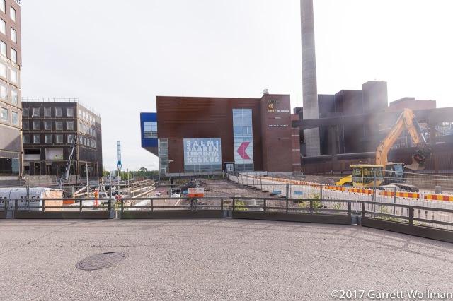 Salmisaari sports center, next to a power plant